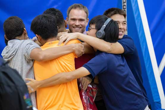 ICS Singapore students group hug on last day of school