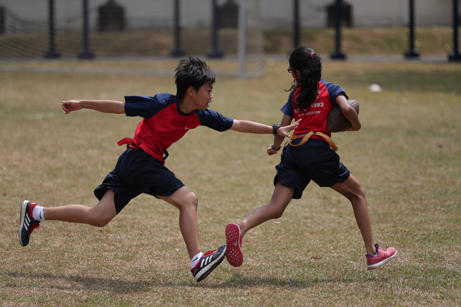 ICS Singapore middle school students playing flag football