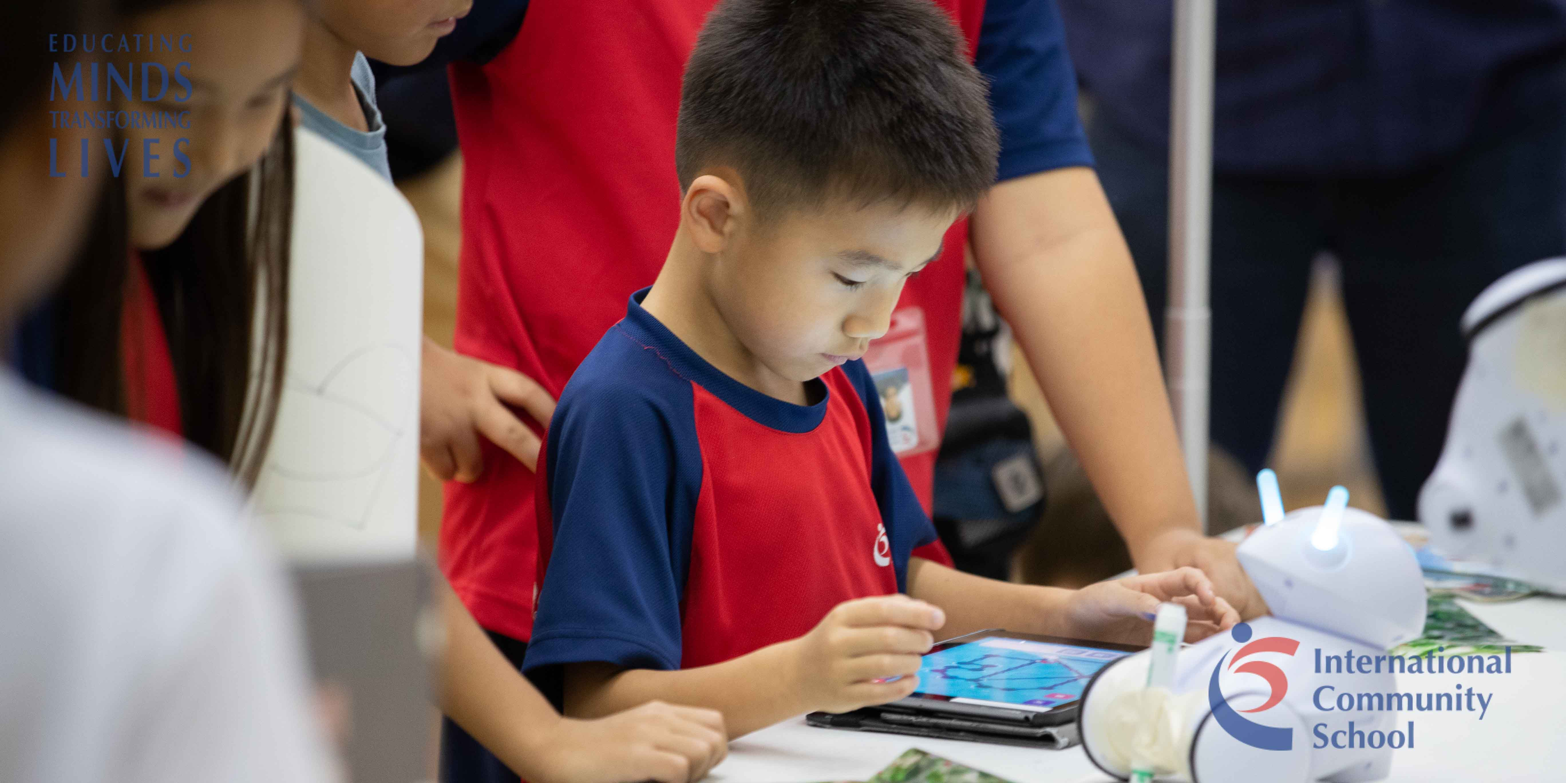 ICS Singapore student working on ipad during media literacy night
