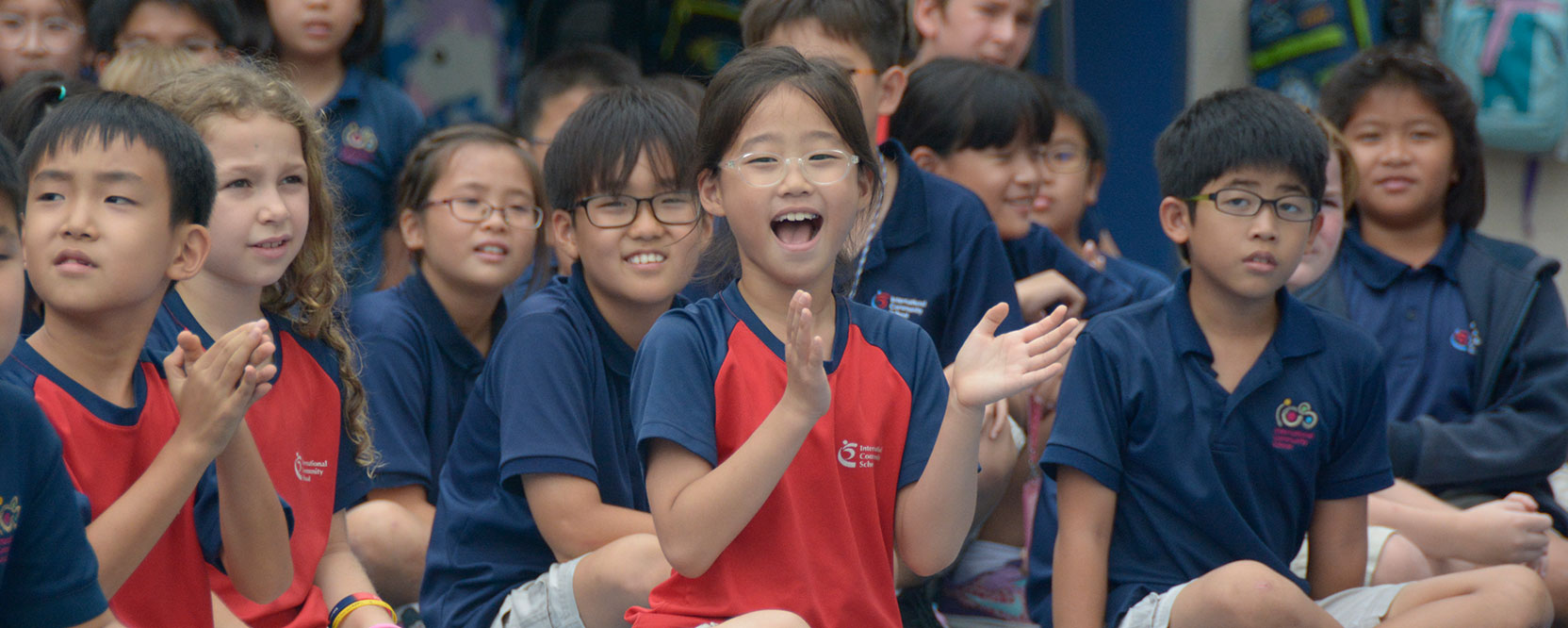 ICS Singapore student clapping happily