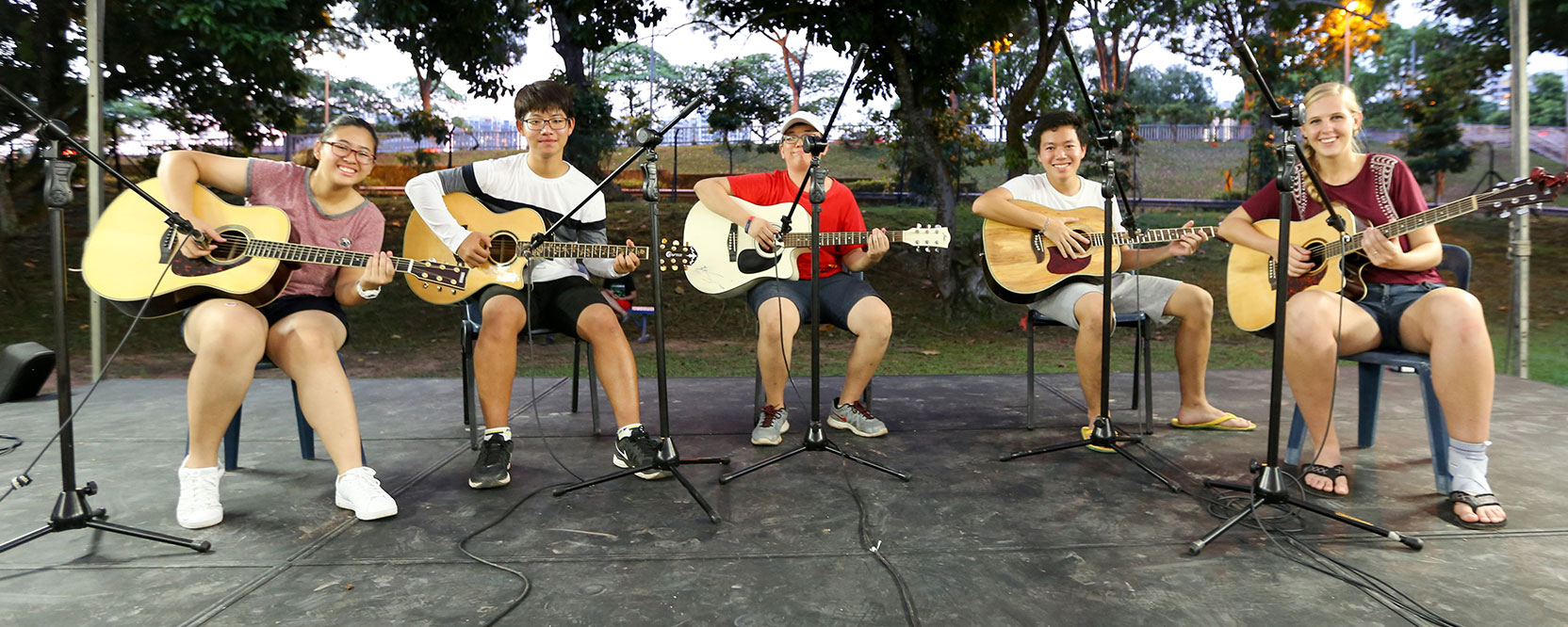 ICS Singapore students performing music on the field