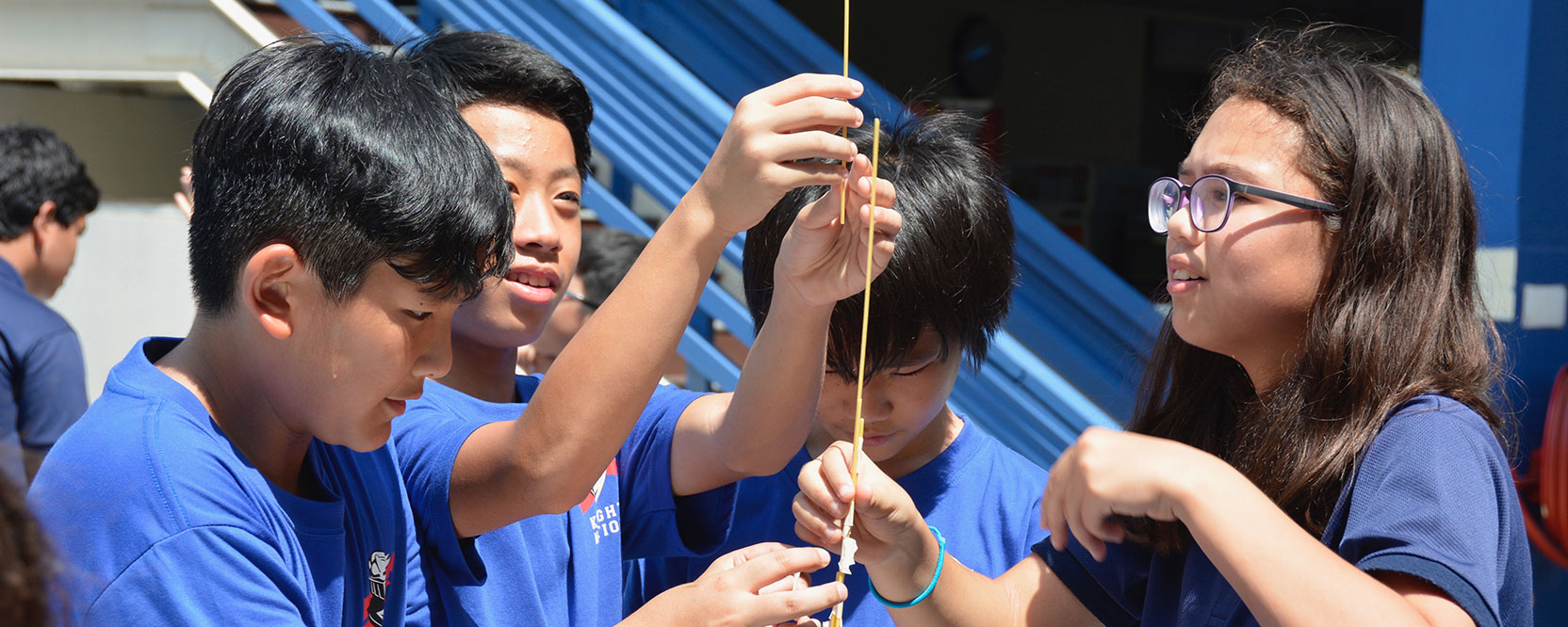 ICS Singapore middle school students performing outdoor science experiment
